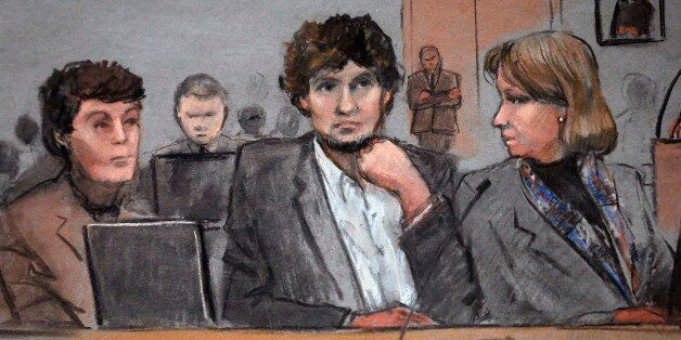 In this courtroom sketch, Dzhokhar Tsarnaev, center, is depicted between defense attorneys Miriam Conrad,...