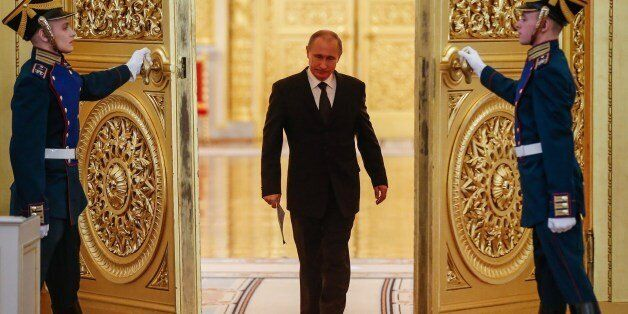 Russian President Vladimir Putin enters a hall before a meeting of the Victory Organizing Committee at...