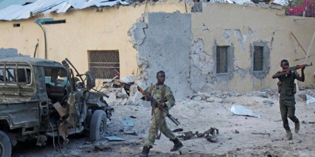 Somali soldiers take position after a bomb that was detonated at the gate of one of Mogadishu's most...