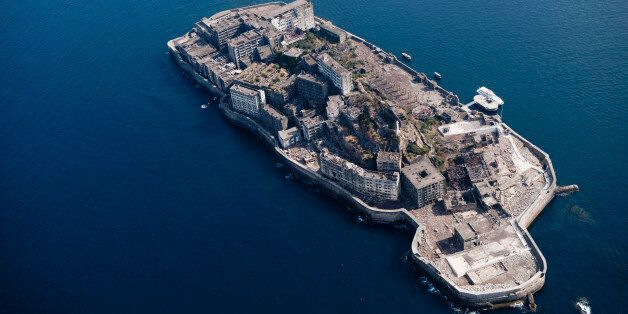 Japan, Nagasaki Prefecture, Kyushu, Nagasaki, Aerial view of Warship island . (Photo by: JTB Photo/UIG...