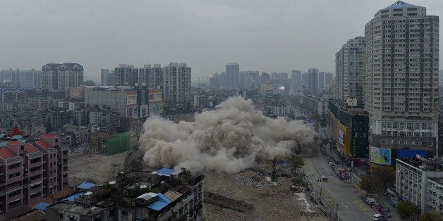 WUHAN, CHINA - DECEMBER 09: (CHINA OUT) 77-meter Yinfeng hotel is demolished by blasting on December...
