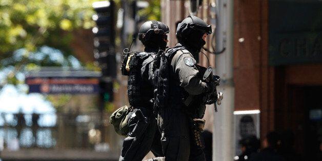 SYDNEY, AUSTRALIA - DECEMBER 15: (AUSTRALIA & NEW ZEALAND OUT) Police secure the area near Lindt Chocolate...