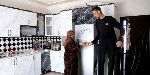 MARDIN, TURKEY - NOVEMBER 09: Sultan Kosen, world's tallest living male at 2.51 meters, and his wife,...