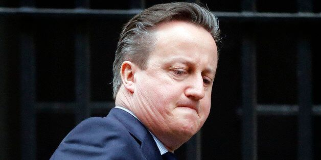 Britain's Prime Minister David Cameron leaves 10 Downing Street for Prime Minister Questions at the Houses...