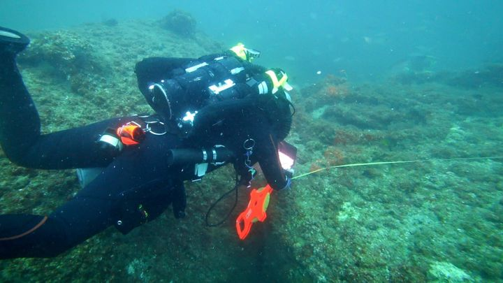 Michael Barnette measuring the wreck of the SS Cotopaxi.