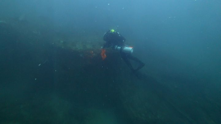 Diver Joe Citelli inspecting the wreck of the SS Cotopaxi.