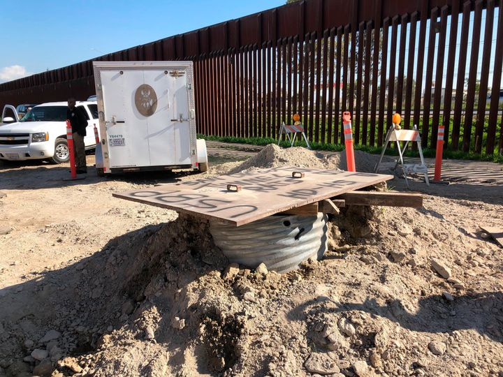 A covered access point leading to a smuggling tunnel is seen on the U.S side of the border wall in San Diego, Calif. on Jan.