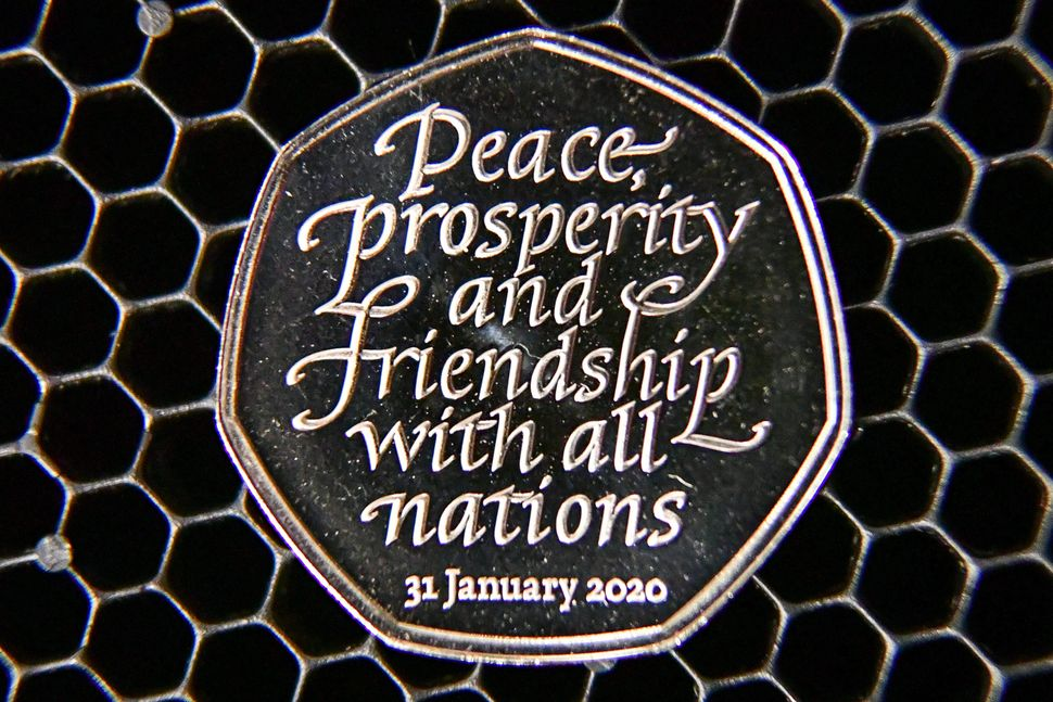 The new 50p Brexit coin, which bears the inscription 'Peace, prosperity and friendship with all nations' and the date the UK