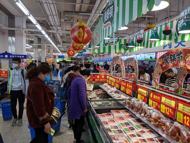 Everybody's wearing masks by the hot pot meats aisle at Shenzhen's