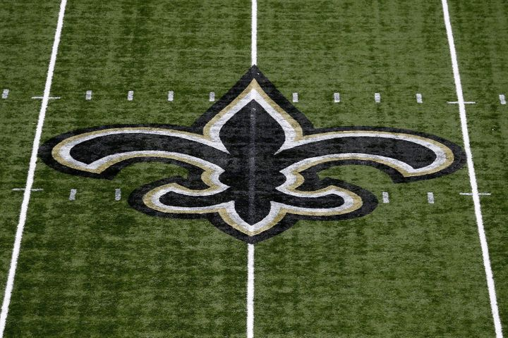 NEW ORLEANS, LA - SEPTEMBER 11:  The New Orleans Saints logo is seen on the field during a game at Mercedes-Benz Superdome on