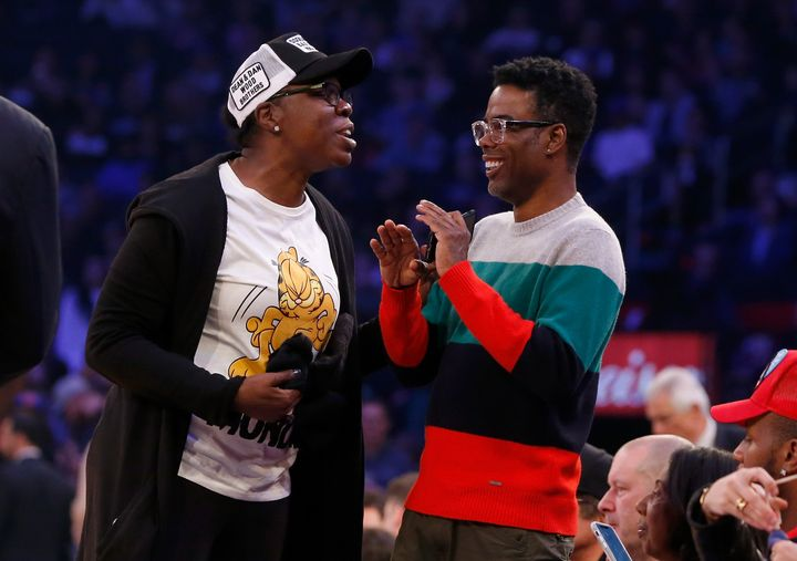 Leslie Jones and Chris Rock attend a game between the New York Knicks and the Golden State Warriors at Madison Square Garden