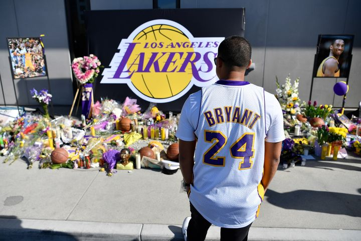 Fans pay their respects at a makeshift memorial for Kobe Bryant in LA.