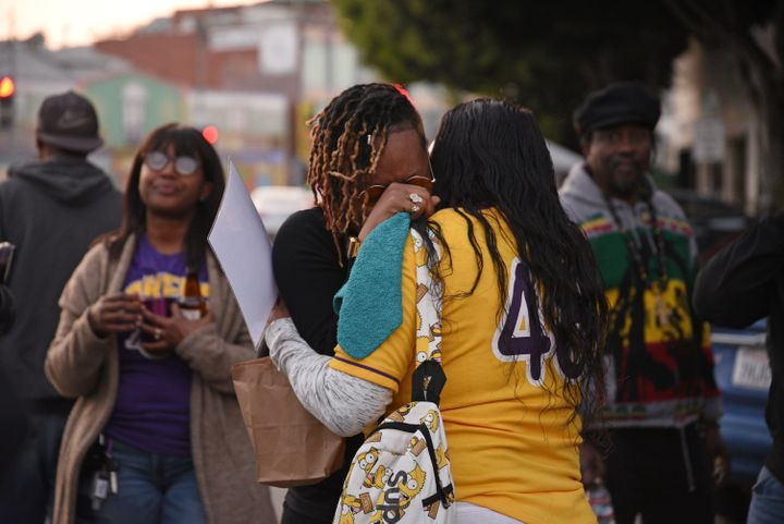 Distraught fan Naima Smith (wearing glasses) crying at a vigil for Kobe Bryant in LA on Sunday.