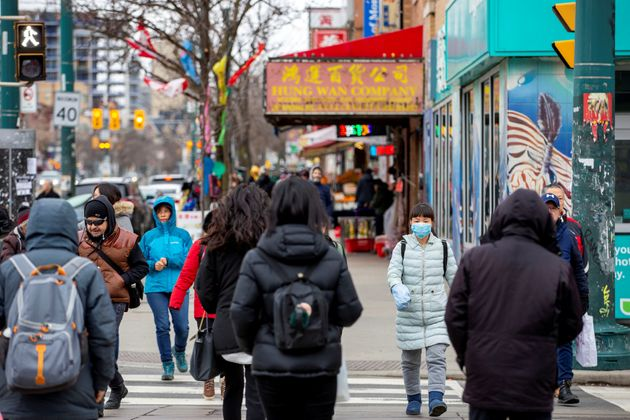 Pedestrians walk in the Chinatown district of downtown Toronto on