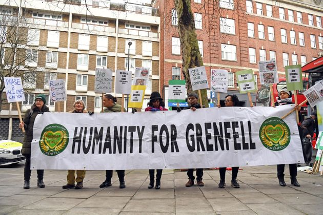 Protesters outside the Grenfell Tower public inquiry in London, where the second part of the inquiry...