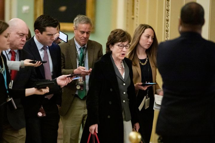 Sen. Susan Collins (R-Maine) is trailed by reporters as she arrives Thursday before the Senate impeachment trial. Collins ann