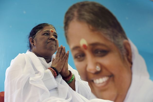 Mata Amritanandamayi attends a public appearance at her ashram in Bangalore on March 14,