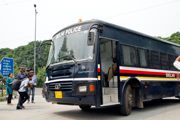 A police van carrying the men convicted in the gang rape case at the Saket Court Complex on September...
