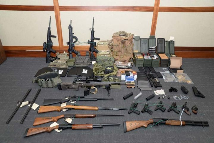 A handout photo provided by the U.S. attorney's office for the District of Maryland of the collection of weapons and am