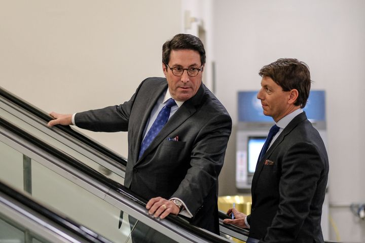 Jay Sekulow (left) speaks with Hogan Gidley, White House Principal Deputy Press Secretary, during the Senate impeachment tria