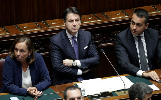 Italian Premier Giuseppe Conte is flanked at left by Interior Minister Luciana Lamorgese, and at right...