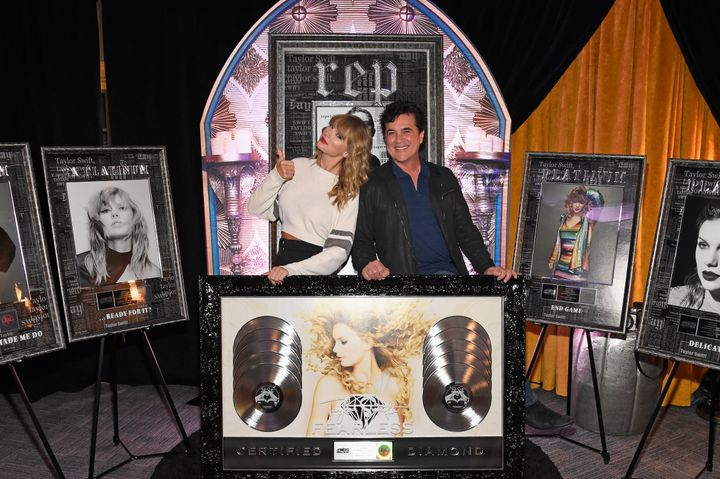 Taylor Swift and Big Machine Records CEO Scott Borchetta at a plaque presentation backstage at MetLife Stadium on July 21, 2018, in East Rutherford, New Jersey.
