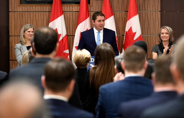 Caucus members give a standing ovation to Conservative Leader Andrew Scheer as he delivers remarks at...