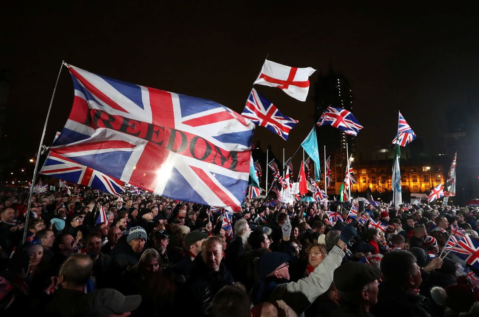 Pro-Brexit demonstrators celebrate on Parliament Square on Brexit day in London, Britain January 31,...