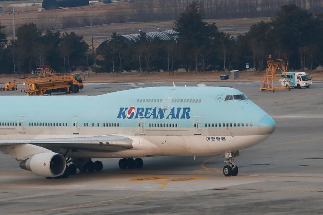 A South Korean chartered plane carrying evacuees from Wuhan, China, taxis after landing at Gimpo International...