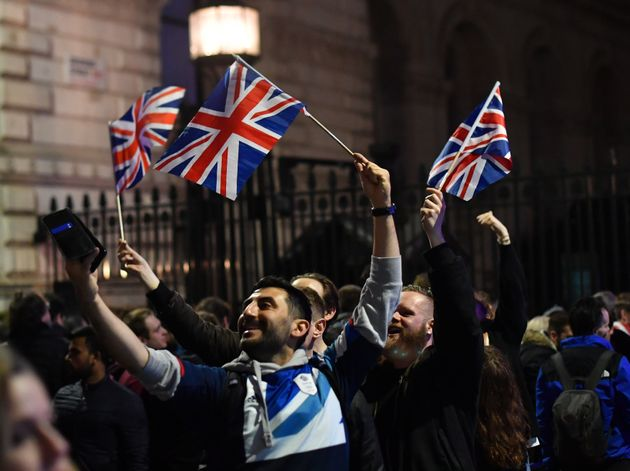 Pro-Brexit supporters take selfies outside Downing Street in London, Britain January 31, 2020. REUTERS/Dylan