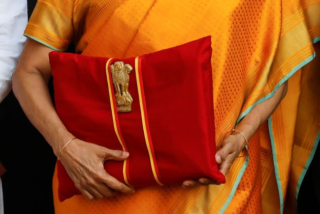 Finance Minister Nirmala Sitharaman holds budget papers on Saturday as she leaves her office to present...