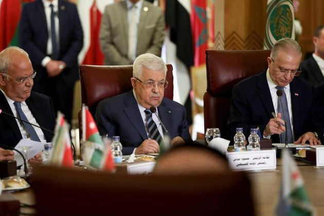 Palestinian President Mahmoud Abbas (C) attends the Arab League's foreign ministers meeting on US...