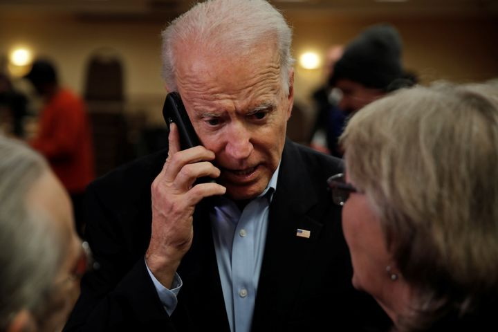 Biden talks on the phone with Ann Cahoon's son during a campaign event in Fort Madison, Iowa, on Jan. 31.