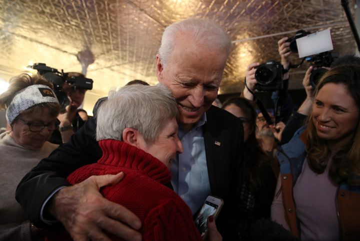 Former Vice President Joe Biden greets a voter during a campaign event on Jan. 31, 2020, in Burlington, Iowa.