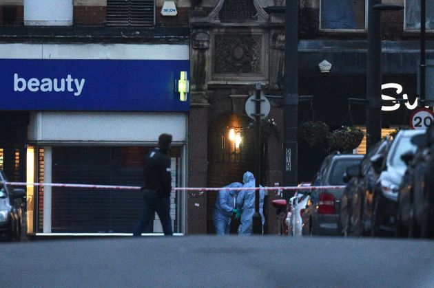 Police forensic officers at the scene in Streatham High Road, south London after a man was shot dead...