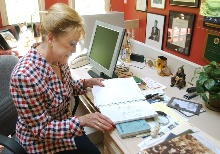 Clark looks through one of her writing notebooks in her studio at her home in Saddle River, N.J., in 2004.