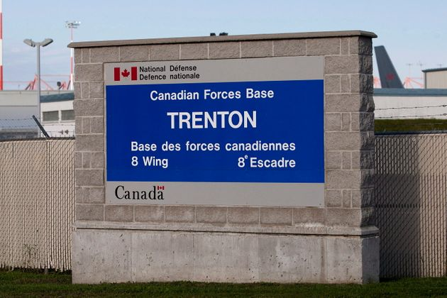 A sign for 8 Wing CFB Trenton is seen on Sept. 29, 2012. The federal government says a plane set to travel...