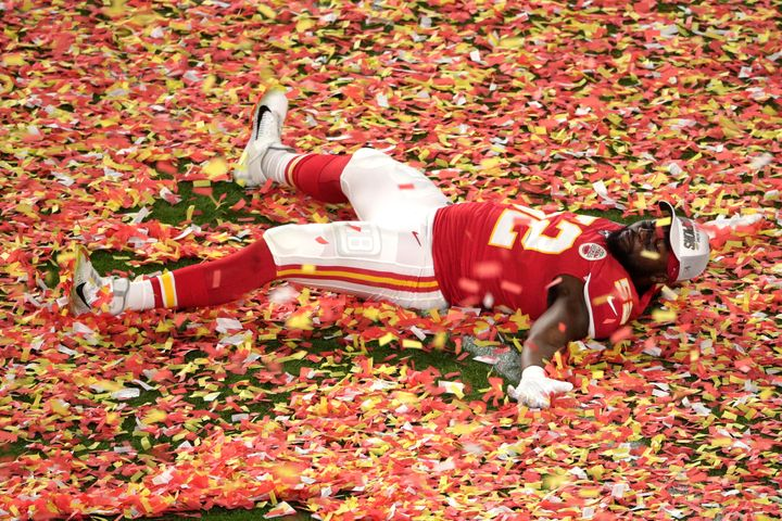 Kansas City Chiefs' Demone Harris plays with the confetti at the end of the Super Bowl.