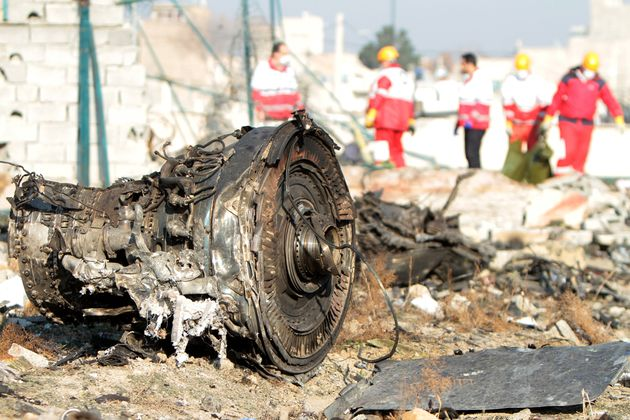 Rescue teams are seen at the site of the Ukrainian plane crash in Tehran on Jan. 8. The downing of the...