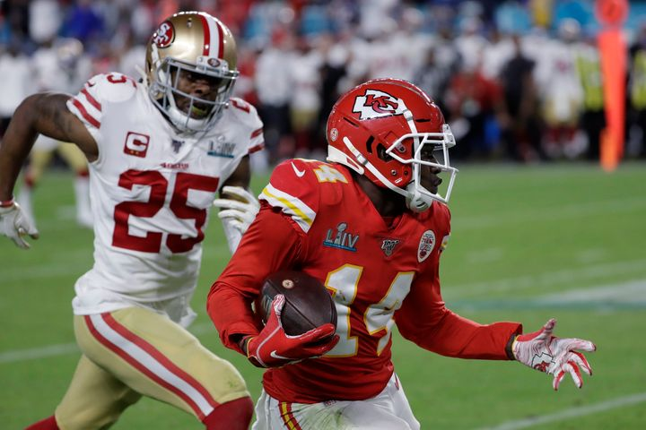 Kansas City Chiefs' Sammy Watkins (14) runs in front of San Francisco 49ers' Richard Sherman (25) during the second half of t
