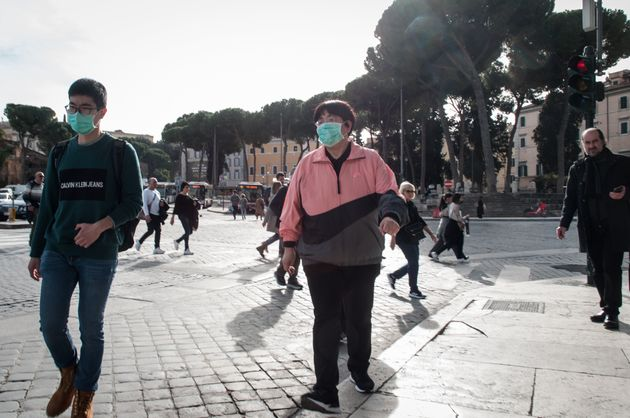 People wearing surgical face mask, in Rome, Italy, on February 3, 2020. Italy has 2 confirmed cases of...