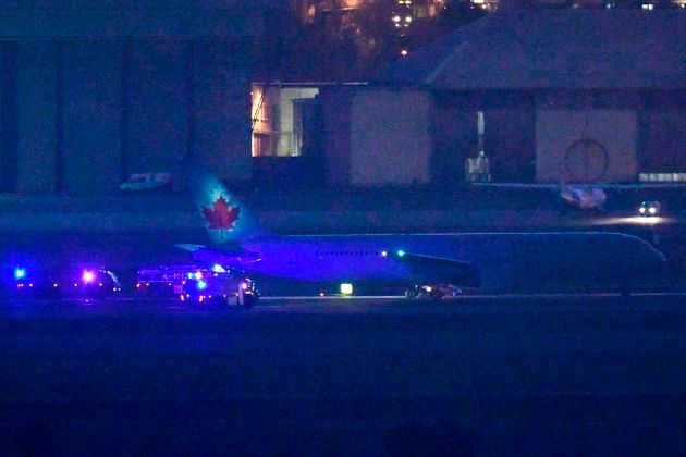 A Air Canada plane makes an emergency landing at Madrid-Barajas Adolfo Suarez Airport on February 03,...
