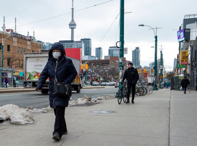 A pedestrian wears a protective mask in Toronto on Jan. 27,