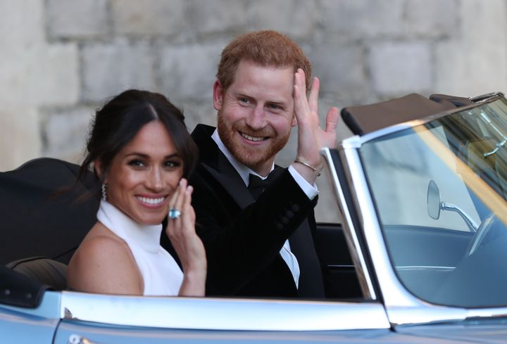 Meghan Markle and Prince Harry on the way to their evening wedding reception at Frogmore House in Berkshire, England, on May 19, 2018.