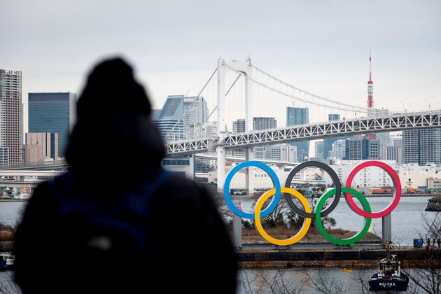 Giant Olympic Rings are installed at the waterfront area at Odaiba Marine Park in Minato Ward, Tokyo...
