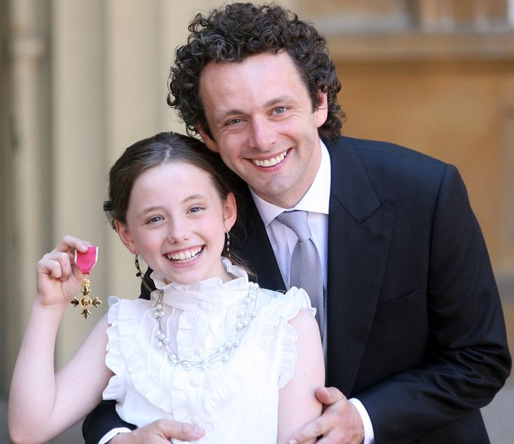 Michael Sheen and his daughter Lily with the Order of the British Empire he received from Queen Elizabeth II during investitures at Buckingham Palace on June 2, 2009.