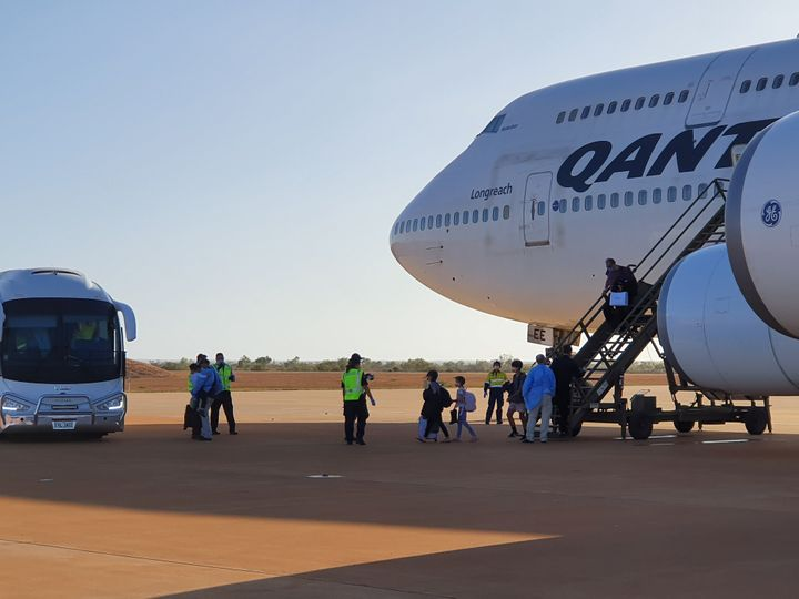 Australian evacuees from Wuhan, China arrive at RAAF base Learmonth in Western Australia on board a chartered Qantas Boeing 747-400 plane prior to their quarantine at Christmas Island.