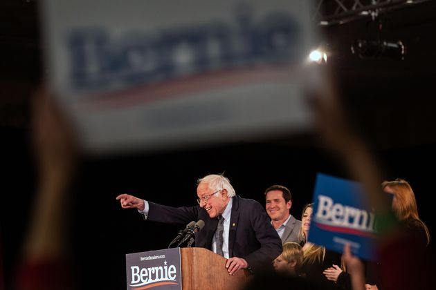 Democratic presidential candidate Vermont Senator Bernie Sanders speaks to supporters as they wait for...
