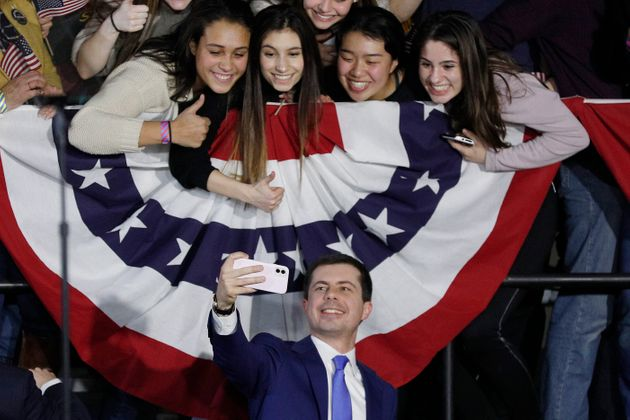 DES MOINES, IOWA - FEBRUARY 03: Democratic presidential candidate Pete Buttigieg takes a selfie with...
