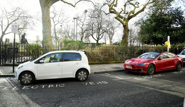 Electric cars using a charging point in